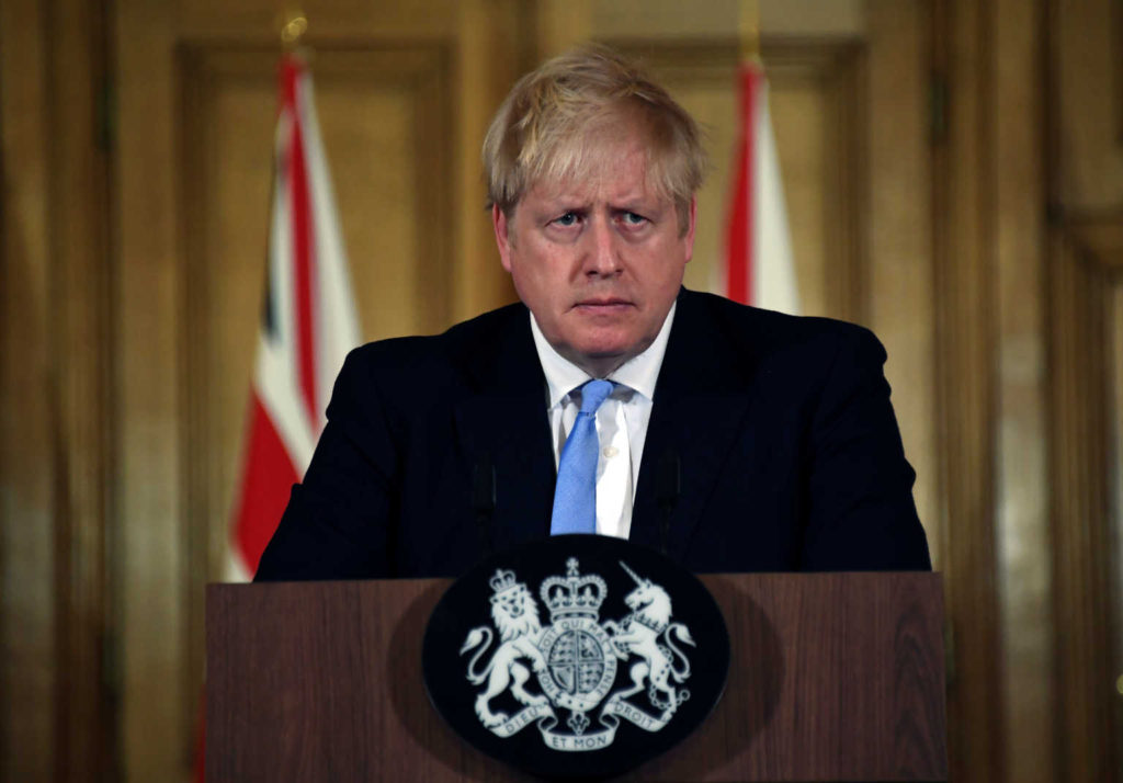Britain's Prime Minister Boris Johnson is seen during a news conference about coronavirus at Downing Street in London
