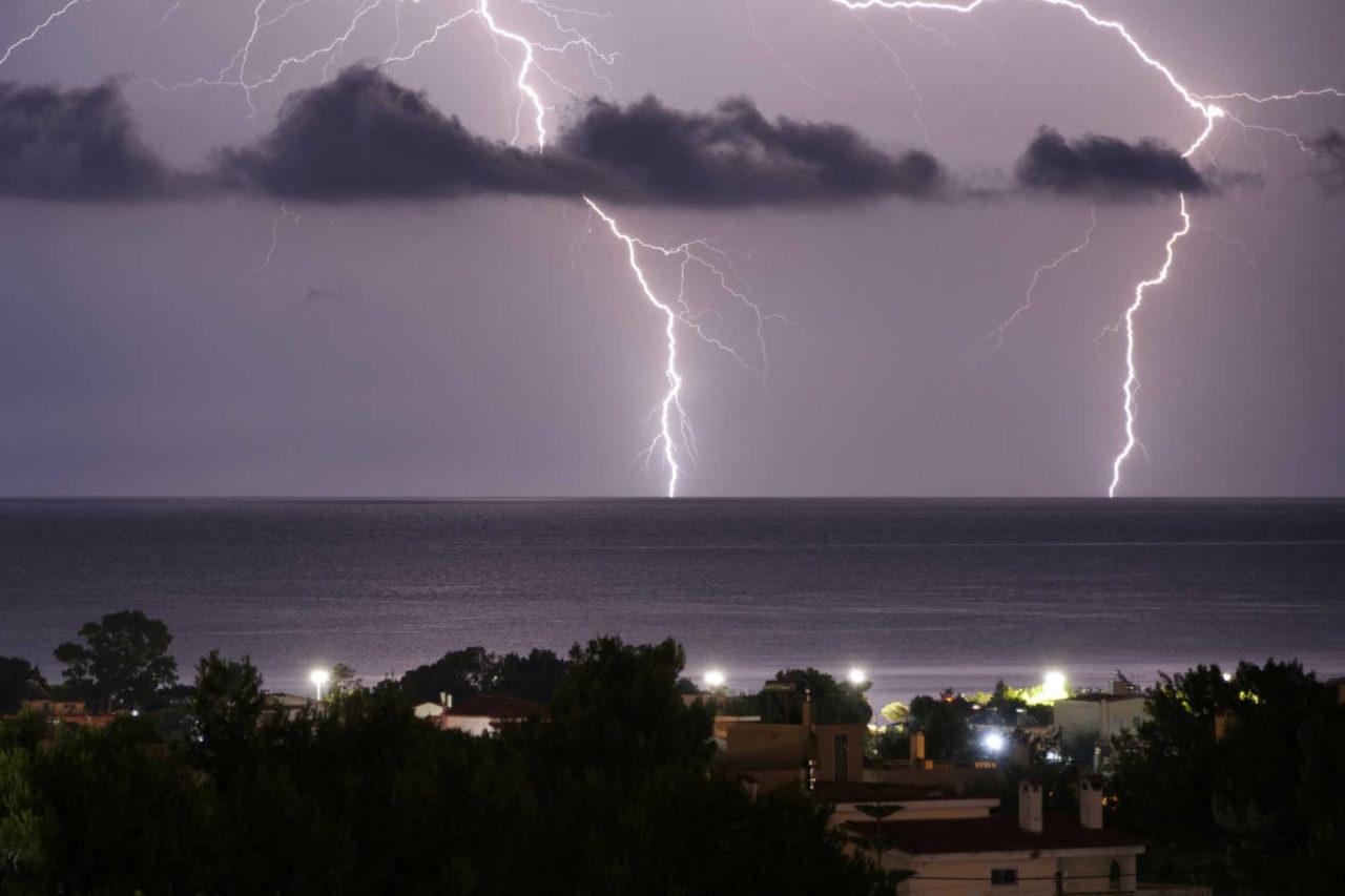 Lightnings strike in the sea off the shore of Artemida